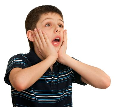 dissappointed: A shocked kid is holding his hands at his face; isolated on the white background