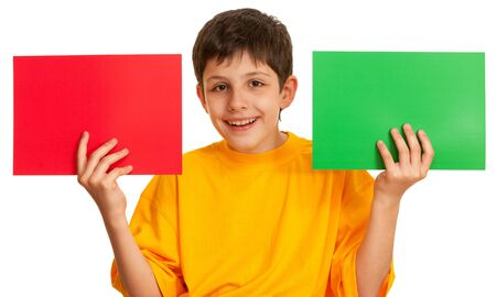 differ: A boy is holding two sheets of different color paper; isolated on the white background