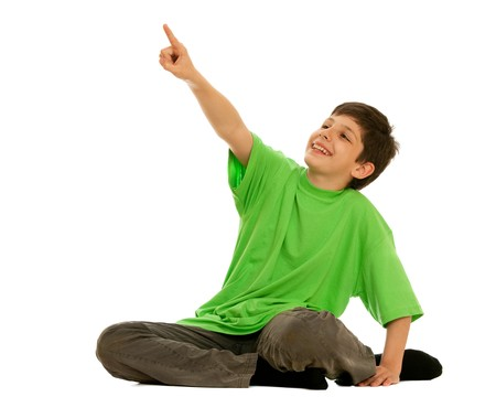 distant: A boy in green is pointing up a distant object; isolated on the white background Archivio Fotografico