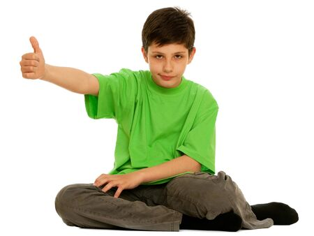 A handsome boy is holding his thumb up; isolated on the white background Stock Photo - 6927466