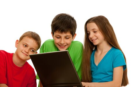 Three happy children are playing with the laptop; isolated on the white background Stock Photo - 6927555