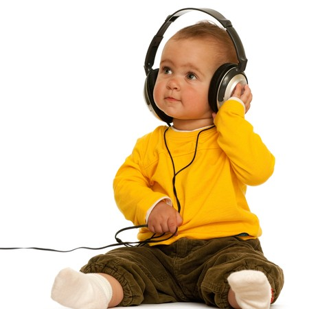 A smiling girl is wearing headphones; isolated on the white background photo