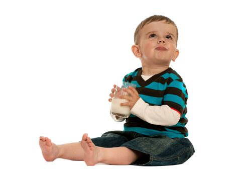 showoff: A drinking milk show-off toddler is laughing; isolated on the white background