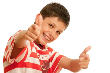 A happy boy is showing thumbs up; isolated on the white background photo