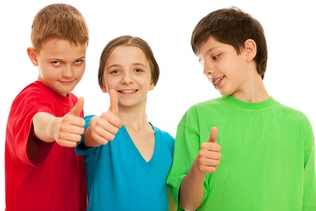 Three happy kids are holding their thumbs up; isolated on the white background photo