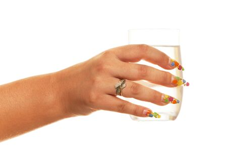 A woman hand with a glass of water; isolated on the white background photo