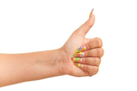 Thumb up; isolated on the white background photo