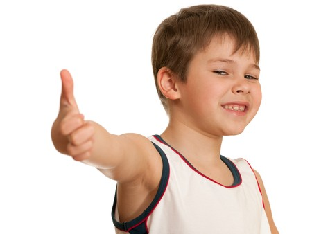 tumb: A smiling boy is showing his tumb up; isolated on the white background
