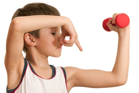 A boy is showing the results of his morning exercises; isolated on the white background photo