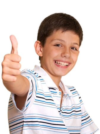 A happy boy is showing his right thumb; isolated on the white background Stock Photo - 7426961