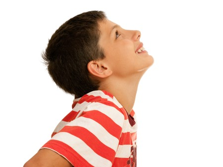 side profiles: A smiling boy is looking upstairs; isolated on the white background