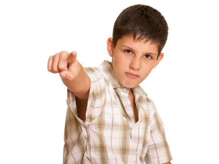 agressive: A portrait of an agressive boy; isolated on the white background Stock Photo