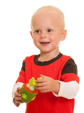 A toddler is holding easter toy; isolated on the white background Stock Photo - 7427172