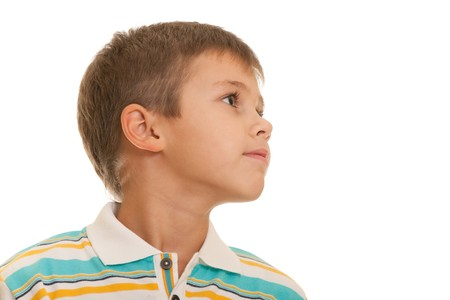 daydreaming: A closeup profile portrait of a seven-year-old kid isolated on the white background