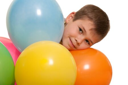 handsome boy: A closeup portrait of a handsome boy looking out of colored balloons; isolated on the white background