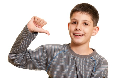 A boy is pointing at himself; isolated on the white background photo