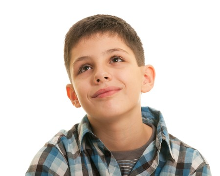 hope indoors luck: A  portrait of a smiling handsome boy looking up; isolated on the white background Stock Photo