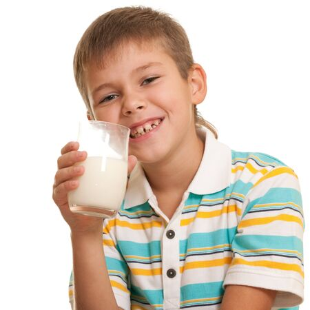 A handsome boy is drinking milk; isolated on the white background Stock Photo - 8203466