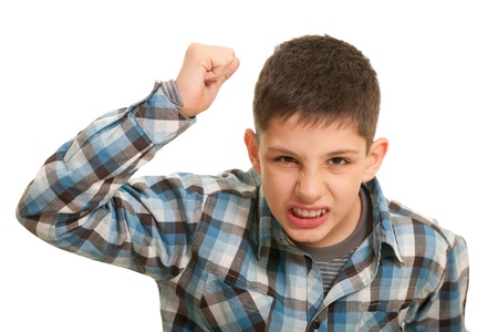 dissatisfaction: An aggressive guy with his fist risen up attempts to hit; isolated on the white background