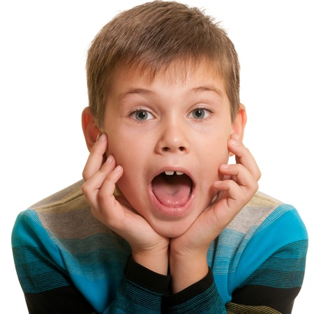 mouth opened: A close up portrait of a handsome kid in a casual shirt with opened mouth; isolated on the white background