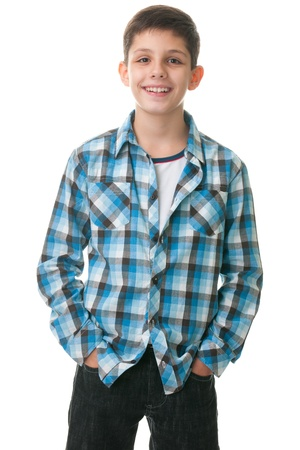 A smiling boy is standing with his hands inside his jeans; isolated on the white background  photo