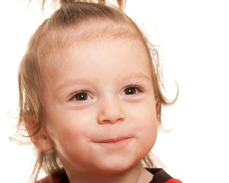 scallywag: A close up portrait of a handsome smiling kid; isolated on the white background Stock Photo