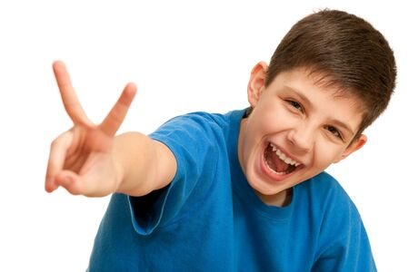 A happy shouting boy showing a victory sign; isolated on the white background  photo