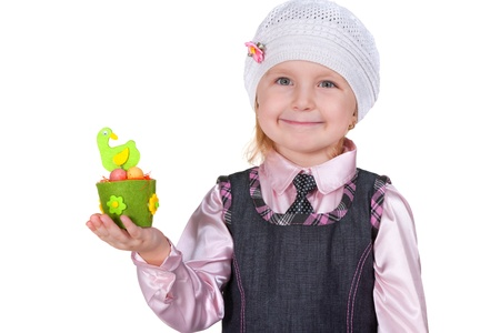 A cheerful laughing kid in pink is holding a toy easter hen; isolated on the white background Stock Photo - 8656560