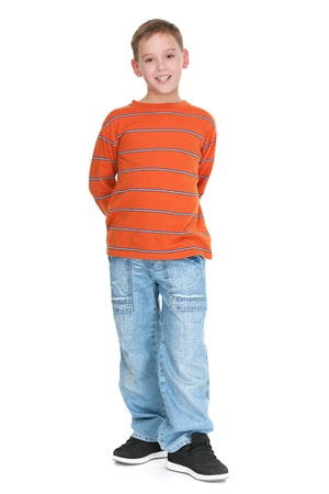 child alone: A full height portrait of a boy dressed in casual; isolated on the white background Stock Photo