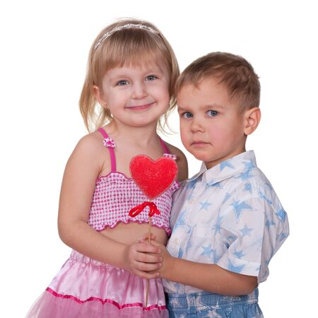 admirer: A cheerful girl and a little boy are holding a valentine heart; isolated on the white background