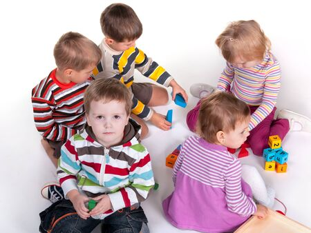 A group of five kids are playing colorful toys photo