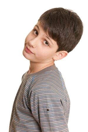 Closeup portrait of a handsome teenager in casual; isolated on the white background  photo