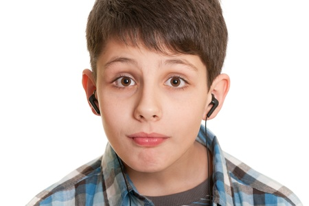 hope indoors luck: Closeup portrait of a handsome teenager with headphones in casual; isolated on the white background Stock Photo