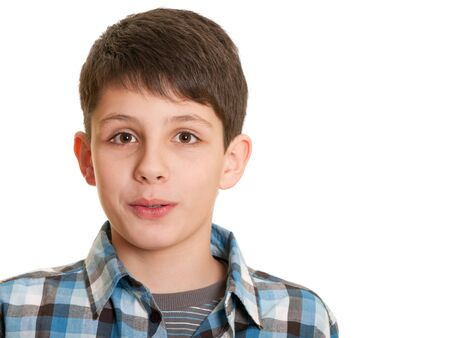 hope indoors luck: Closeup portrait of a handsome teenager in casual; isolated on the white background