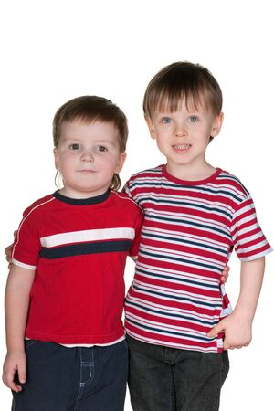 Two cheerful boys are hugging each other; isolated on the white background photo