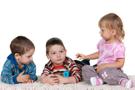 Three playing children; isolated on the white background photo