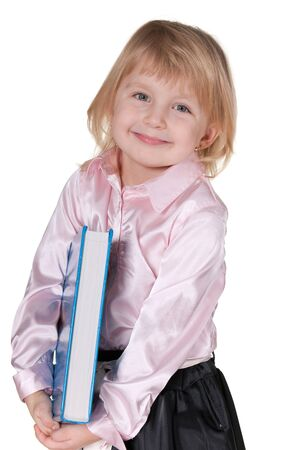 A closeup portrait of a cheerful little girl holding a thick book; isolated on the white background Stock Photo - 9015253