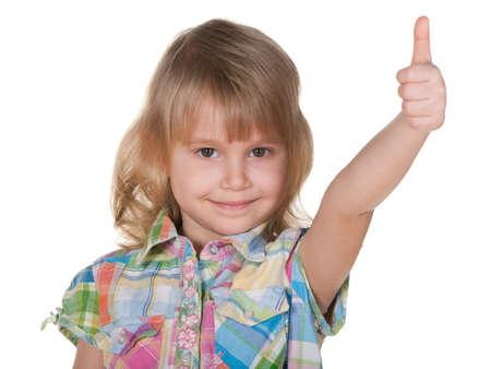 A closeup portrait of a cheerful little girl holding her thumb up; isolated on the white background photo