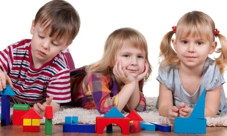kindergarten toys: Three playing blocks children; isolated on the white background Stock Photo