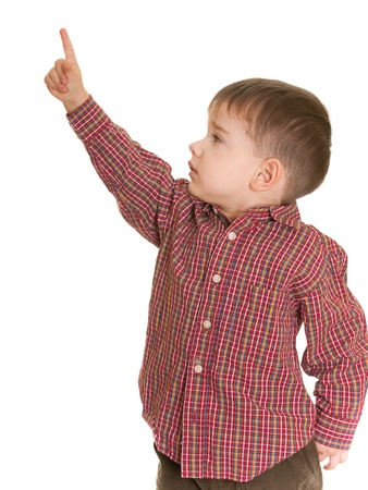 kid pointing: A side portrait of a little boy holding his finger up to show how tall he is; isolated on the white background