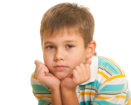 daydreaming: A portrait of a kid holding his head with palms; isolated on the white background
