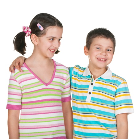 admirer: Two smiling kids in striped casual shirts isolated on the white background