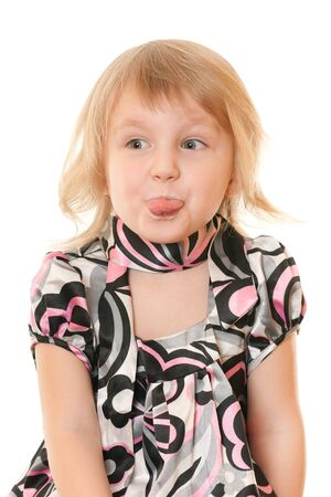 A closeup portrait of a cheerful pretty blonde girl showing her tongue; isolated on the white background photo