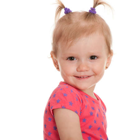 A closeup portrait of a smiling pretty little girl; isolated on the white background photo
