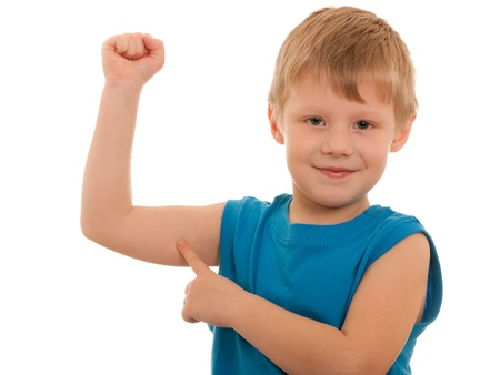 strong boy: A smiling boy is showing the results of his morning exercises; isolated on the white background