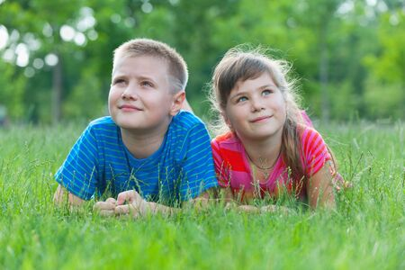Two dreaming children are lying on the grass Stock Photo - 9875083