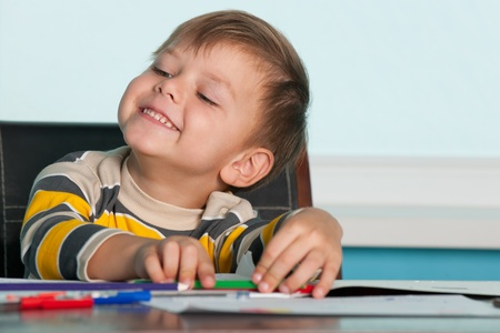 successes: Little boy is proud of its successes Stock Photo