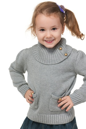 sweater girl: A portrait of a fashion little girl in grey sweater; isolated on the white background Stock Photo