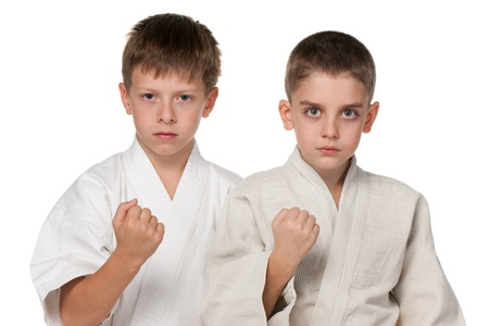 A portrait of boys in kimono; isolated on the white background photo