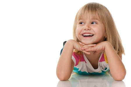 A cheerful little girl is looking away; isolated on the white background Stock Photo - 11069298